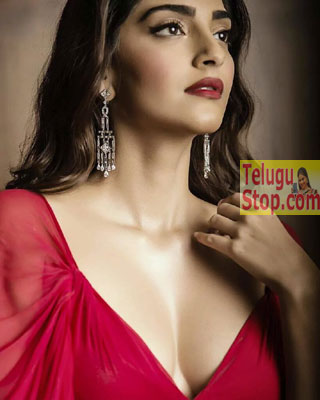 Red Hot Beauty flaunting cleavage