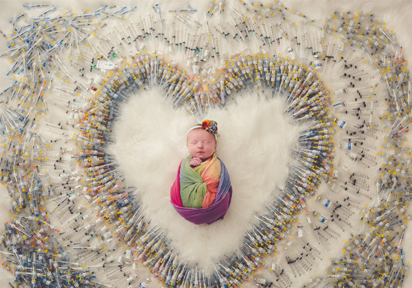 Baby London Was Wrapped In A Rainbow Blanket And With 1616 Needles-