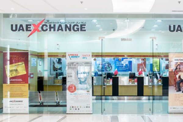 Indian NRIs Queline At Foreign Currency Exchange In UAE-