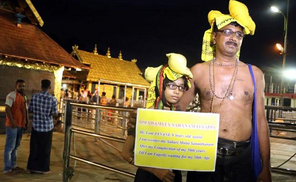9 Years Old Girl Holds Plug Card With Inspiring Message In Sabarimala-