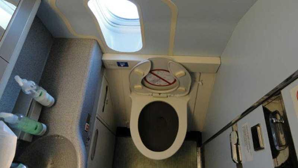 Why You Can't Use The Bathroom On A Plane Before Takeoff And Landing-
