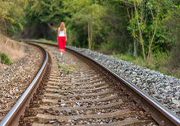 She faced the train to die but her clothes struck her death-