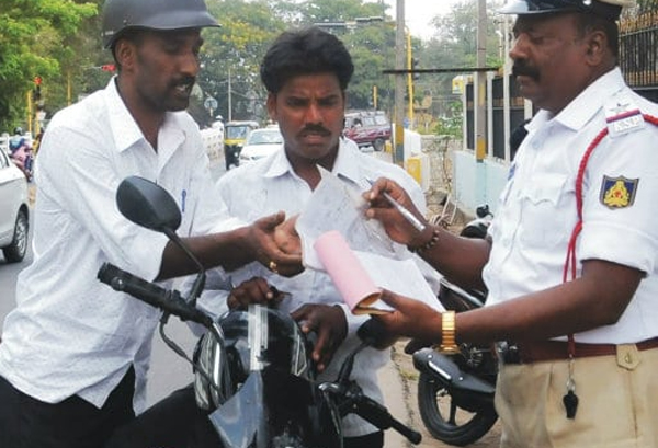 Vehicles With Press Police And Indian Armed Is Traffic Offence-Stickers On Traffic Offence