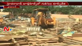 Tension Situation: Revenue Officers Demolish Illegal Huts at Banjara Hills