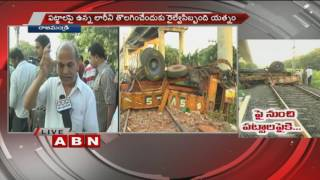 Truck falls from road cum bridge in Rajahmundry | Driver, cleaner injured