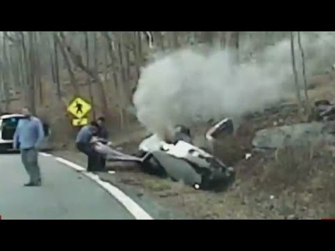 Officers pull woman from burning car
